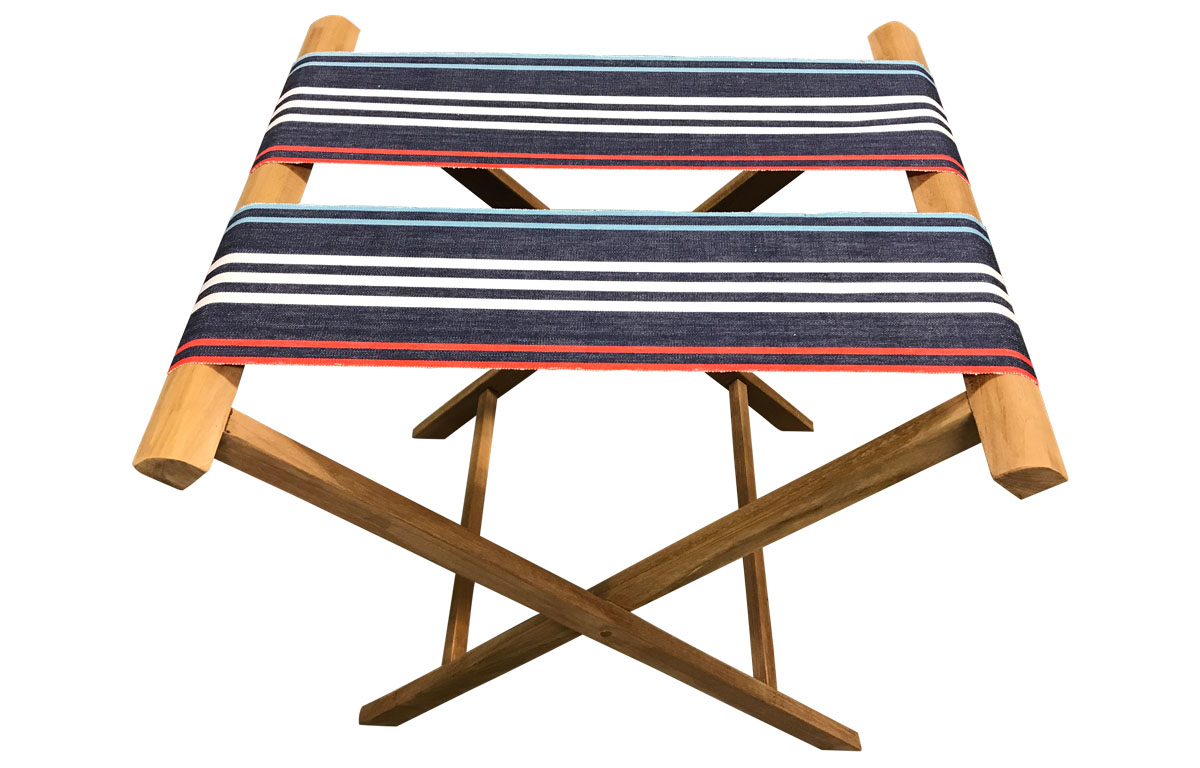 Folding Luggage Rack with extra wide webbing of navy blue, pale blue, red and white stripes