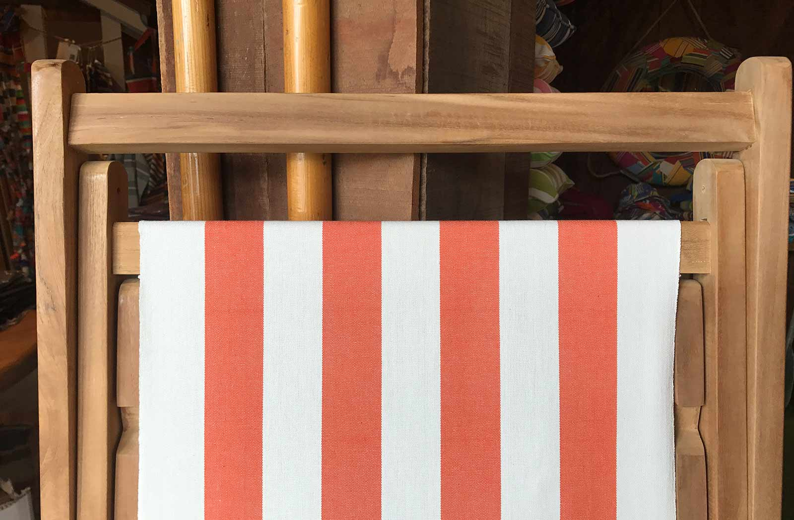 teak deckchair with orange and white sling