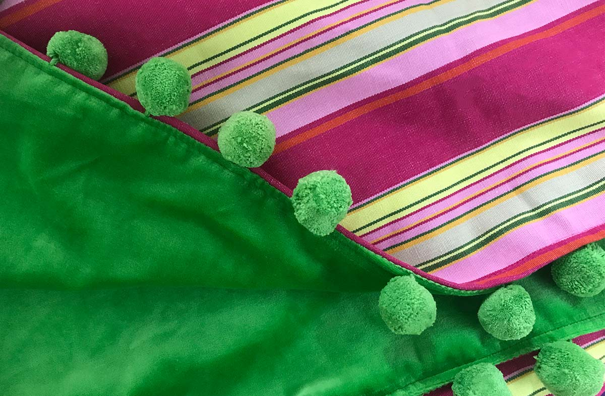 Reversible Pink Stripe / Green Velvet Throw Trimmed with Green or Pink Pompoms