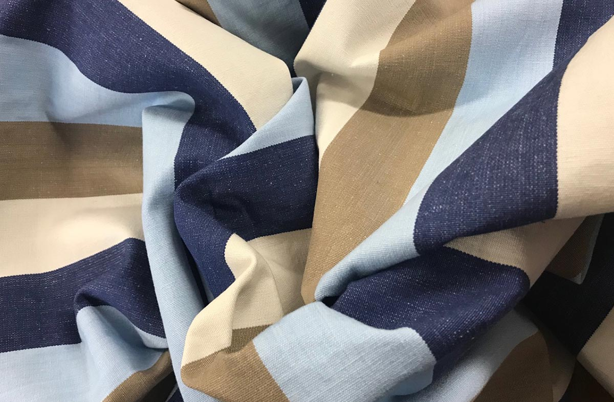 Light blue, dark blue, beige and white striped fabric