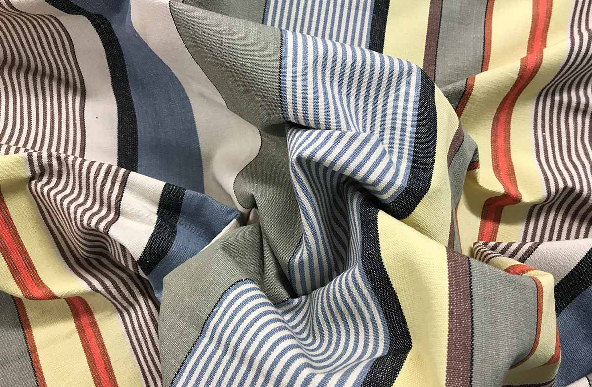 Striped Fabric of pale denim blue, oyster beige, light grey and lemon yellow stripes