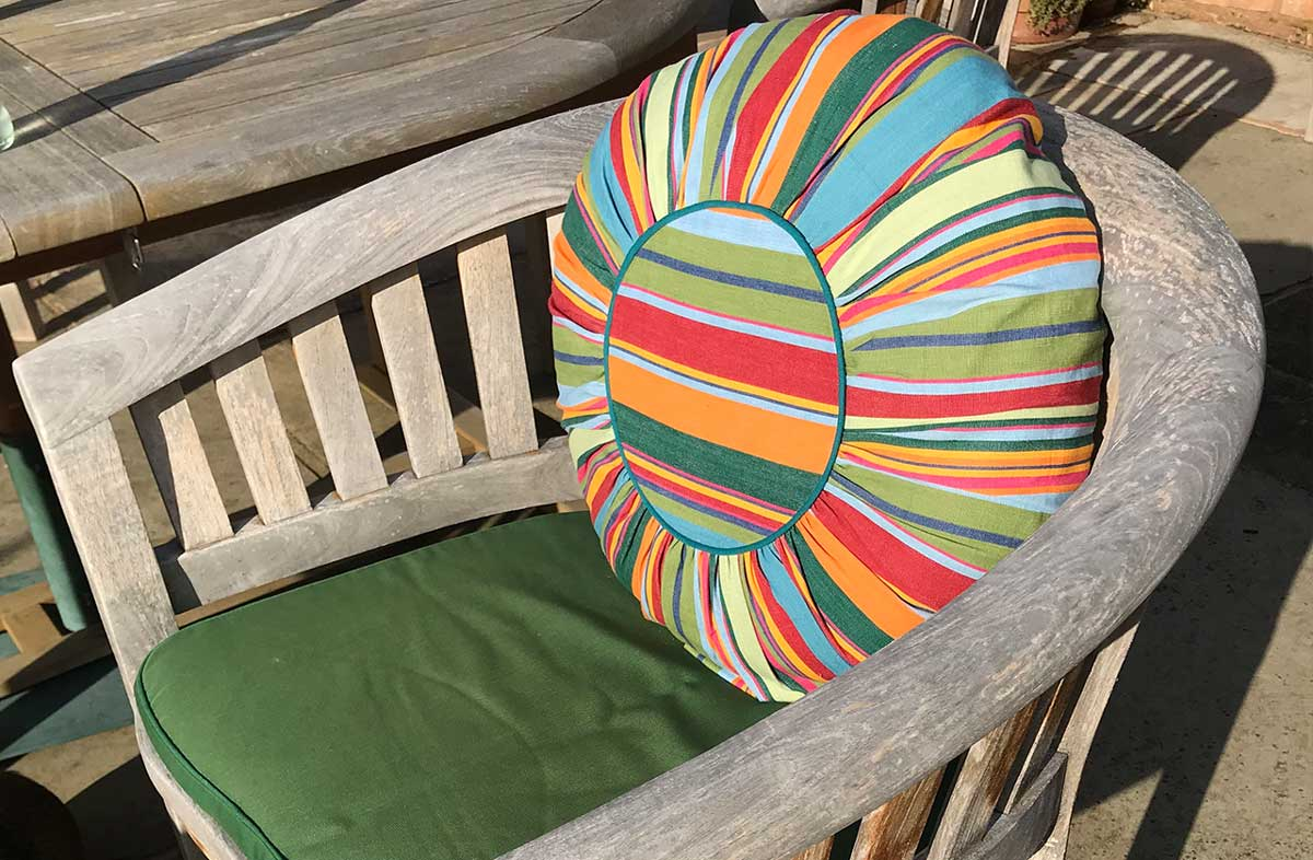 Multi Stripe Round Cushions bottle green, blues, red